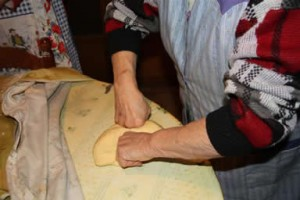 knidding the oreillette dough